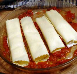 Step 7: Arrange Cannelloni in Baking Dish Over Tomato Sauce
