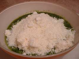 Step 3: Fold the Grated Pecorino and Parmigiano into the Basil Paste