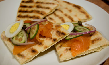 grilled focaccia topped with smoked salmon and cucumber